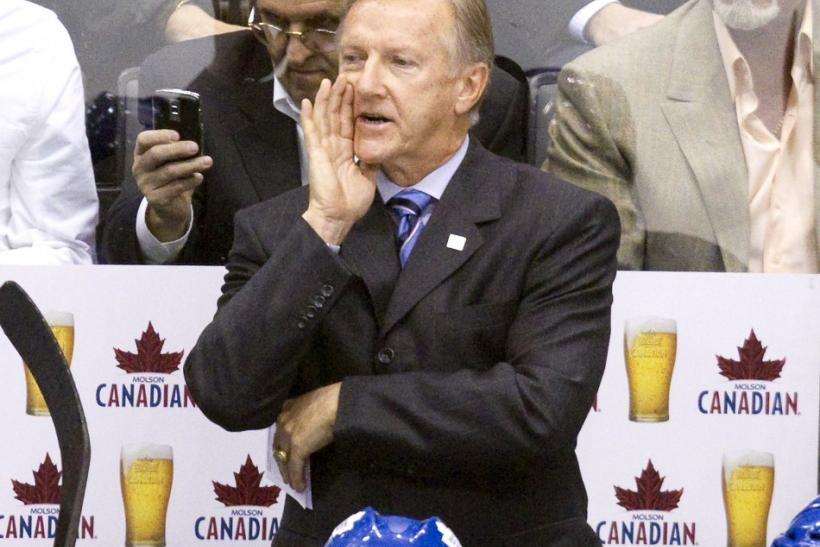 Maple Leafs' head coach Ron Wilson yells at the referee in their NHL hockey game against the Canucks in Toronto