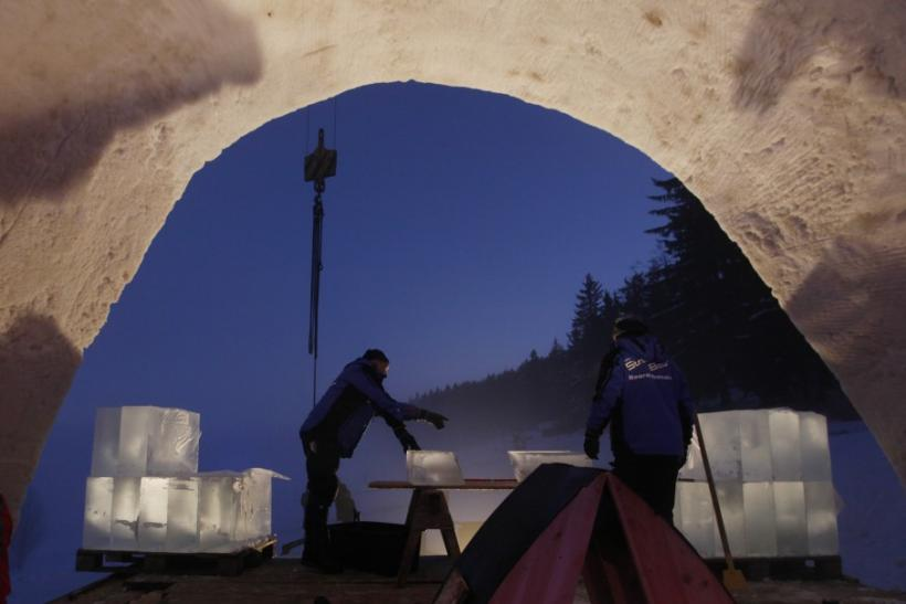 People work at the construction site of a Catholic church made of snow in the Bavarian village of Mitterfirmiansreut, near the German-Czech border