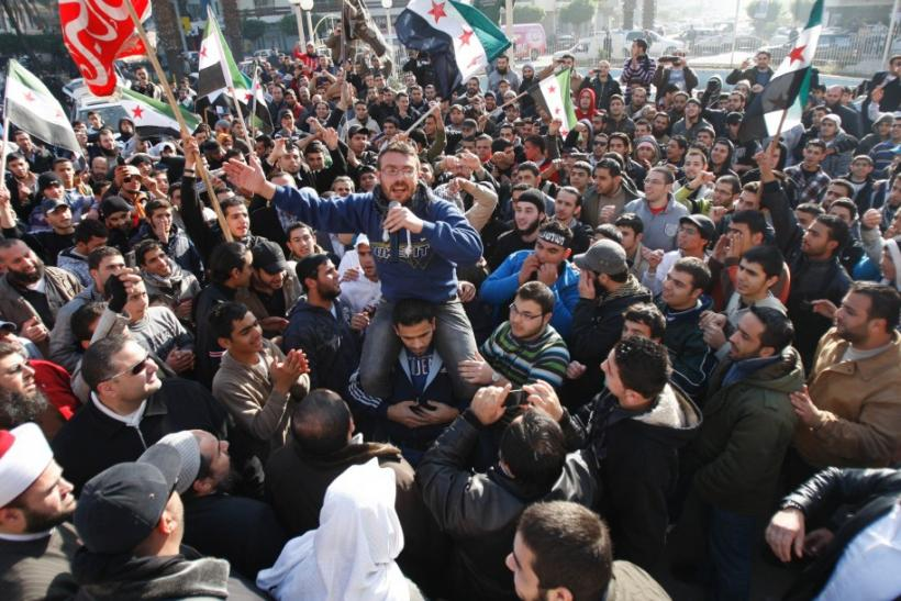 Syrian and Lebanese protesters chant slogans against Syrian President Bashar al-Assad during a protest in solidarity with Syria's anti-government protesters, in the port-city of Tripoli, in north Lebanon