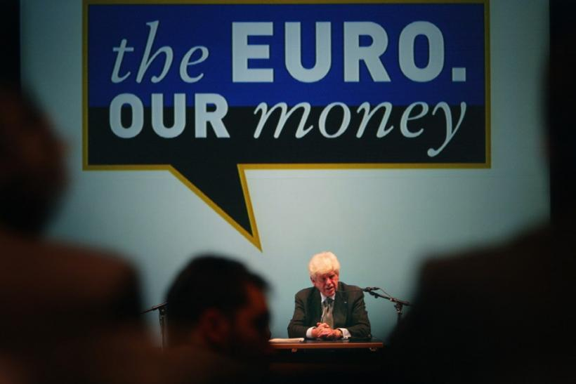 """Wim Duisenberg, President of the European Central Bank (ECB) addresses the international media addresses the international media as he sits under a large logo which reads """"the euro our money"""" during the news conference to introduce the euro bank"""