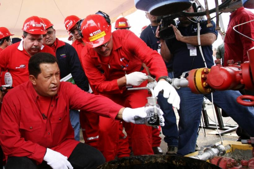 Hugo Chavez takes sample of Venezuelan oil