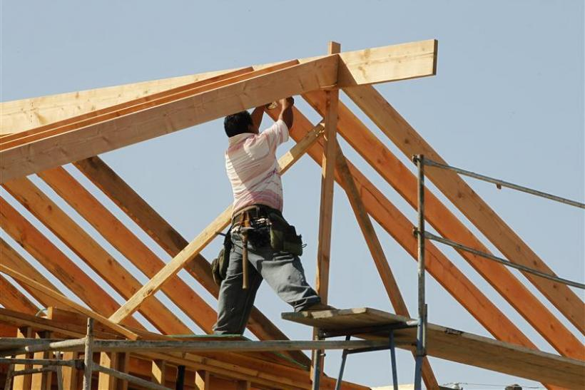 A construction worker works on the framework for a single family home currently under construction in Los Angeles