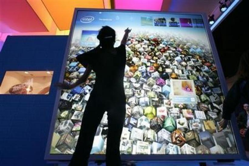 Karen Nguyen interacts with a display at the Intel booth during the 2010 International Consumer Electronics Show (CES) in Las Vegas, Nevada, January 8, 2010.