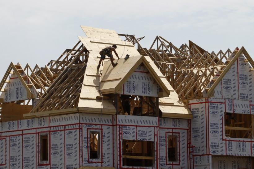 A builder works on the the roof of a new home under construction in the Montreal suburb of Brossard