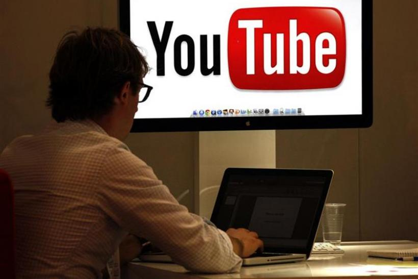 A visitor is seen at a YouTube stand