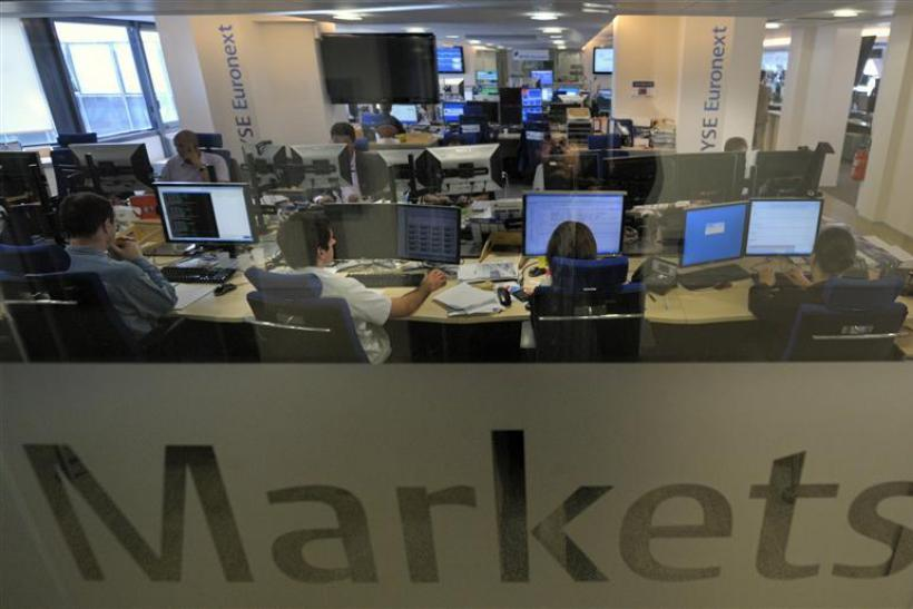 Experts work at their screens in the NYSE Euronext cash markets operations room in Paris