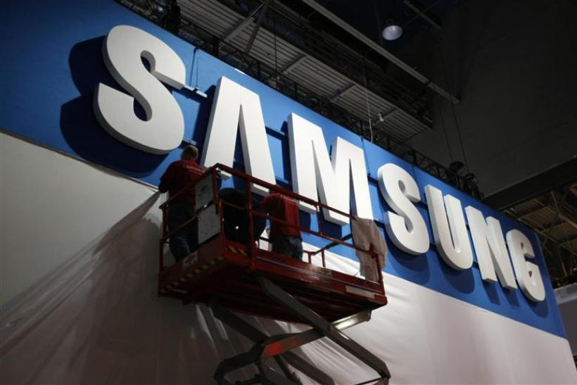 Workers prepare the booth for Samsung at the Consumer Electronics Show opening in Las Vegas.