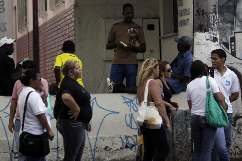 Haitians talk near a Pastoral do Migrante shelter in Manaus