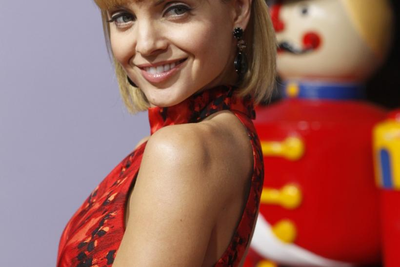 """Actress Mena Suvari poses at the premiere of the new film """"A Very Harold & Kumar 3D Christmas"""" in Hollywood"""