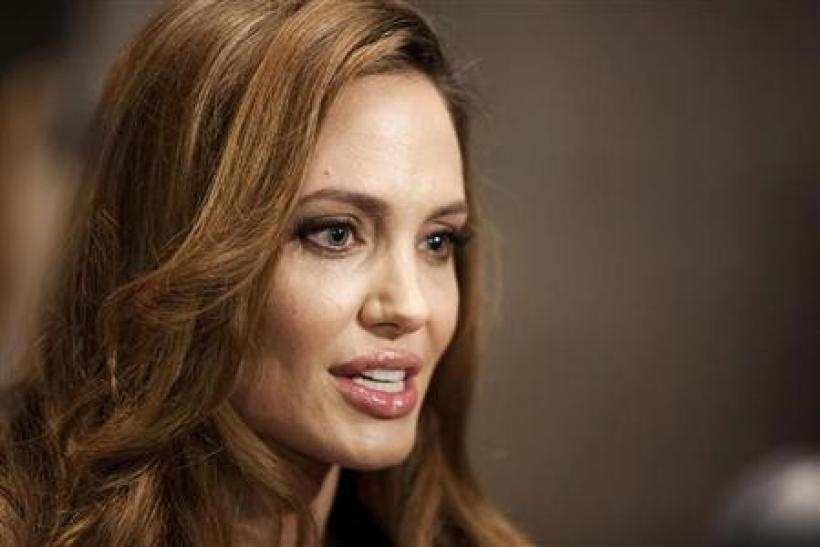 Angelina Jolie speaks during an interview before the premier of ''In the Land of Blood and Honey'', a movie she wrote and directed, in Washington
