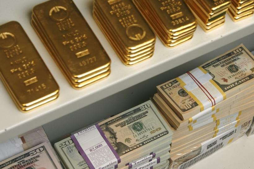Gold bars and US Dollar bills are pictured in a safe in a bank in Vienna.