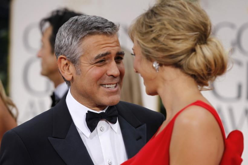 "Actor George Clooney from the film ""The Descendants"" and ""The Ides of March"" and girlfriend Stacy Keibler arrive at the 69th annual Golden Globe Awards in Beverly Hills"