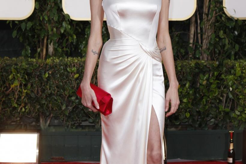 Actress Angelina Jolie poses as she arrives at the 69th annual Golden Globe Awards in Beverly Hills, California