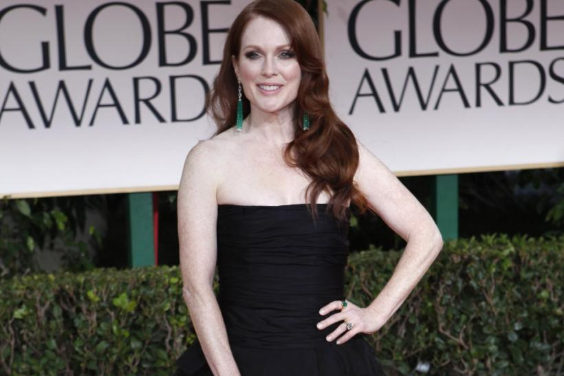 Actress Julianne Moore poses as she arrives at the 69th annual Golden Globe Awards in Beverly Hills, California