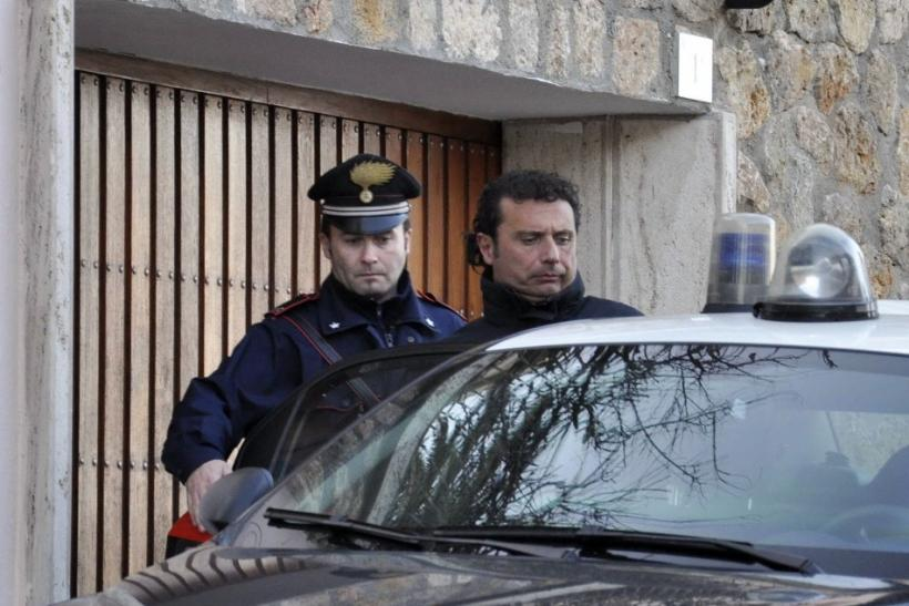 Costa Concordia cruise liner captain Francesco Schettino is escorted by a Carabinieri in Grosseto