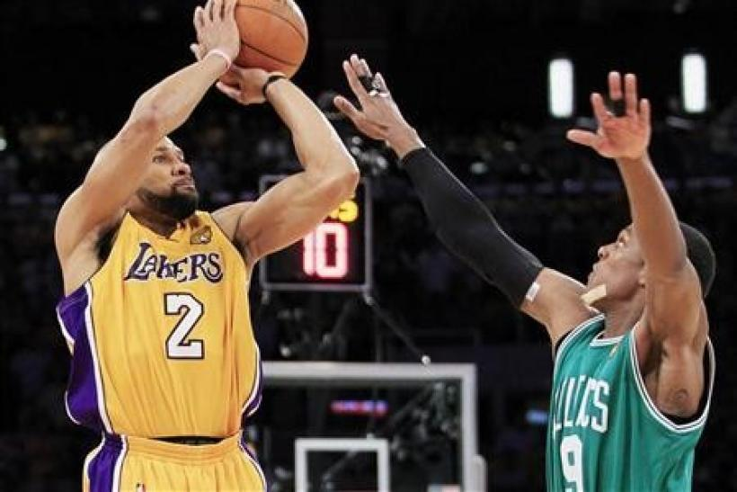 Los Angeles Lakers' Derek Fisher shoots over Boston Celtics' Rajon Rondo during the fourth quarter in Game 7 of the 2010 NBA Finals series in Los Angeles, California