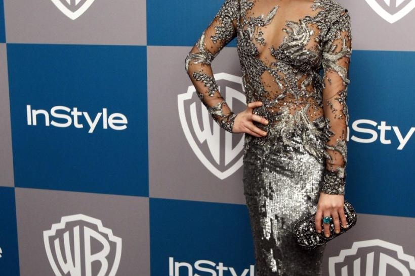 Actress Lea Michele poses at the 13th annual Warner Bros. and InStyle after-party following the 69th annual Golden Globe Awards in Beverly Hills, California
