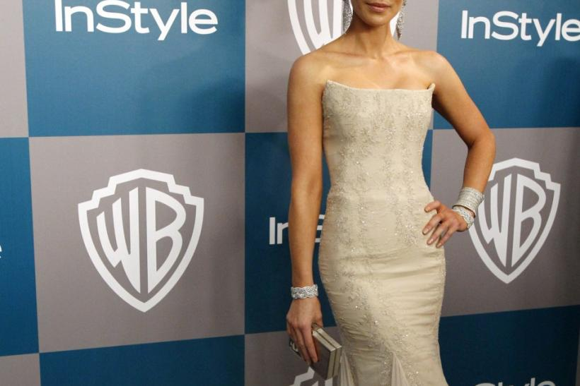 Actress Kate Beckinsale poses at the 13th annual Warner Bros. and InStyle after-party following the 69th annual Golden Globe Awards in Beverly Hills, California