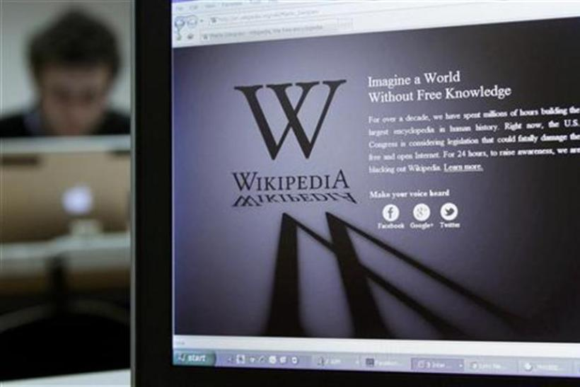 A reporter's laptop shows the Wikipedia blacked out opening page in Brussels