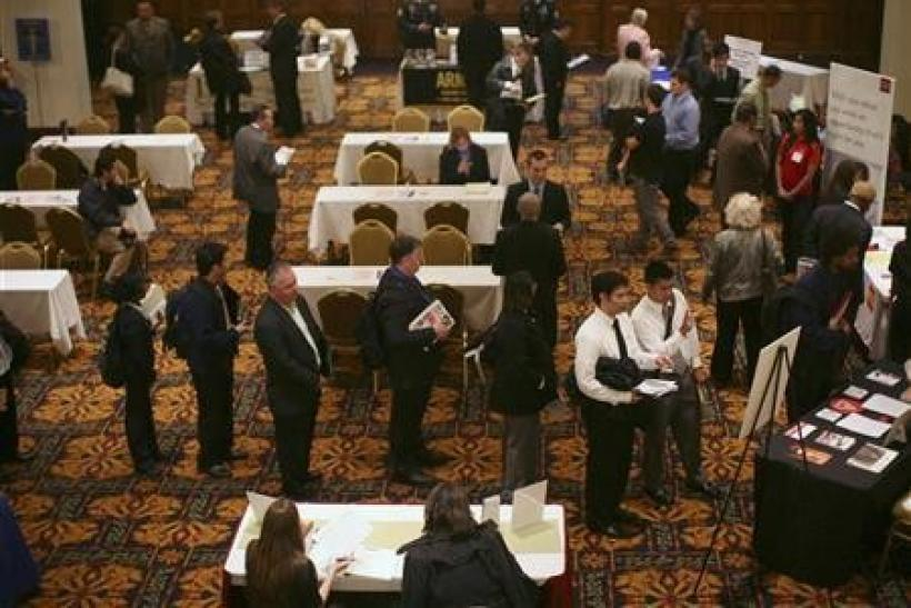 Jobless claims near 4-year low, inflation muted