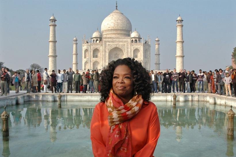 Entertainment host Oprah Winfrey poses for pictures in front of the historic Taj Mahal during her visit to the northern Indian city of Agra