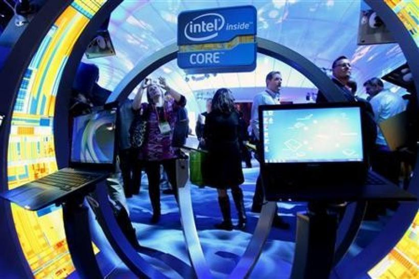 A woman takes a photo of ultrabooks at the Intel booth during the 2012 International Consumer Electronics Show (CES) in Las Vegas, Nevada January 10, 2012.