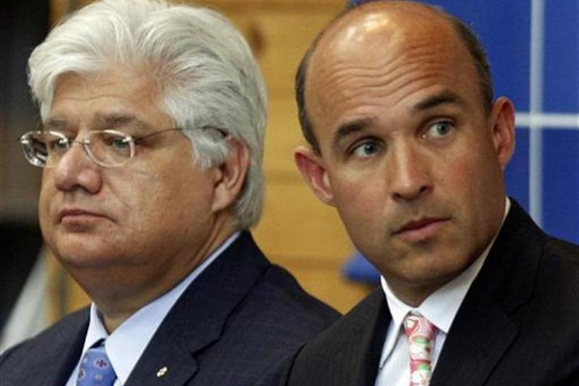 Research in Motion co-CEO Jim Balsillie and President and co-CEO Mike Lazaridis listen during the annual general meeting of shareholders in Waterloo