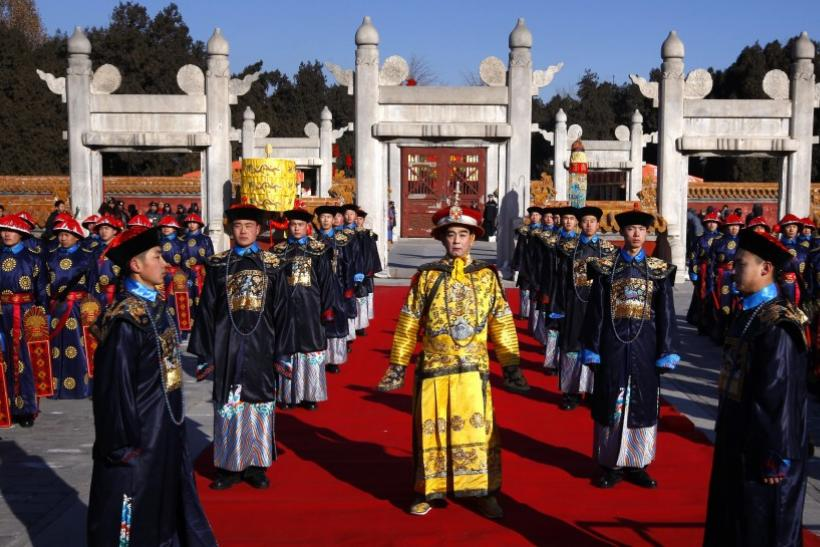 An actor wearing traditional costume takes part in an ancient Qing Dynasty ceremony at Ditan Park, also known as the Temple of Earth, in Beijing