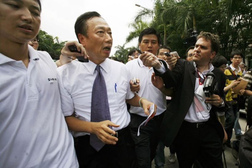 Taiwanese tycoon Terry Gou (2nd L), founder of Foxconn, speaks to journalists as he visits a Foxconn factory in the township of Longhua in the southern Guangdong province in this May 26, 2010 file photo.
