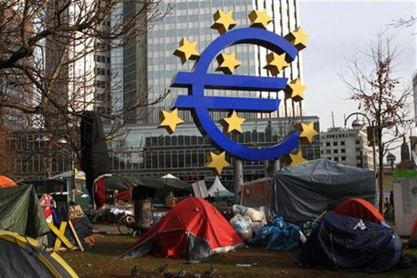 Tents of 'Occupy Frankfurt' movement are pictured next to Euro currency sign sculpture in front of ECB headquarters in Frankfurt