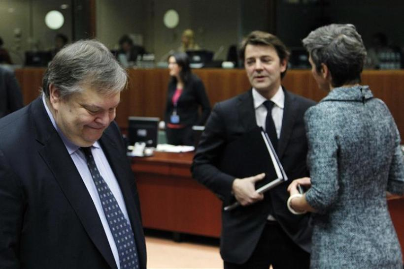 Greece's Finance Minister Venizelos, French counterpart Baroin (C) and Danish Economy Minister Vestager attend the EU finance ministers meeting in Brussels