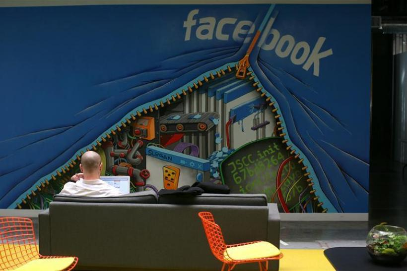 An employee works on a computer at the new headquarters of Facebook in Menlo Park