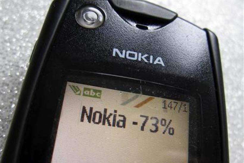 A text message of the Q4 Nokia results is seen on the screen of an early Nokia mobile phone in this photo illustration taken in Paris January 26, 2012.