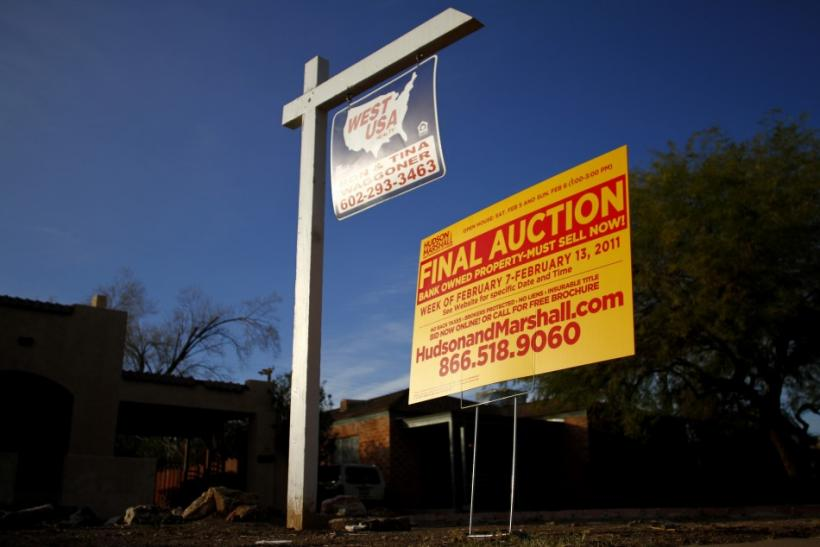 A realtor and bank-owned sign is displayed near a house for sale in Phoenix, Arizona, January 4, 2011.