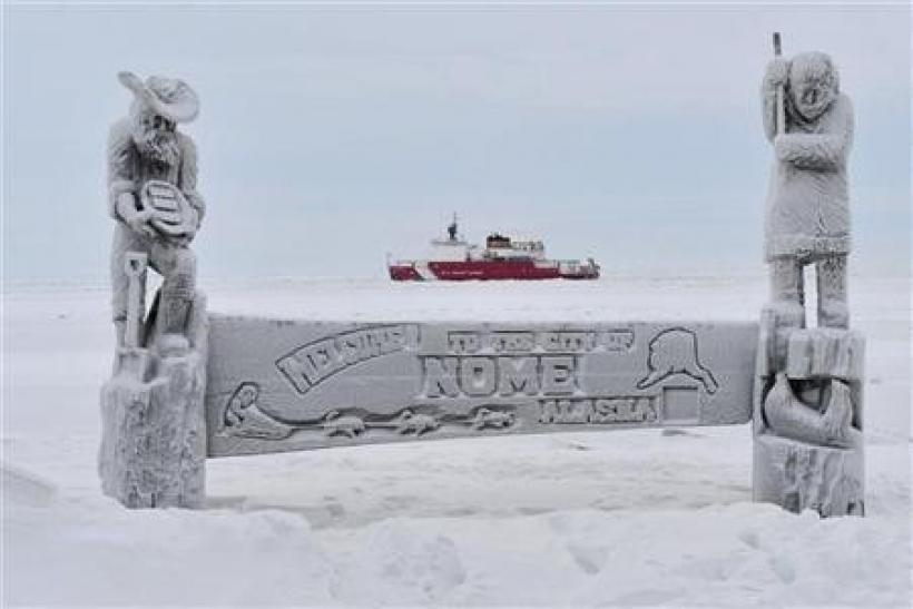 The U.S. Coast Guard cutter Healy breaks ice near the coast of Nome, Alaska, January 14, 2012.