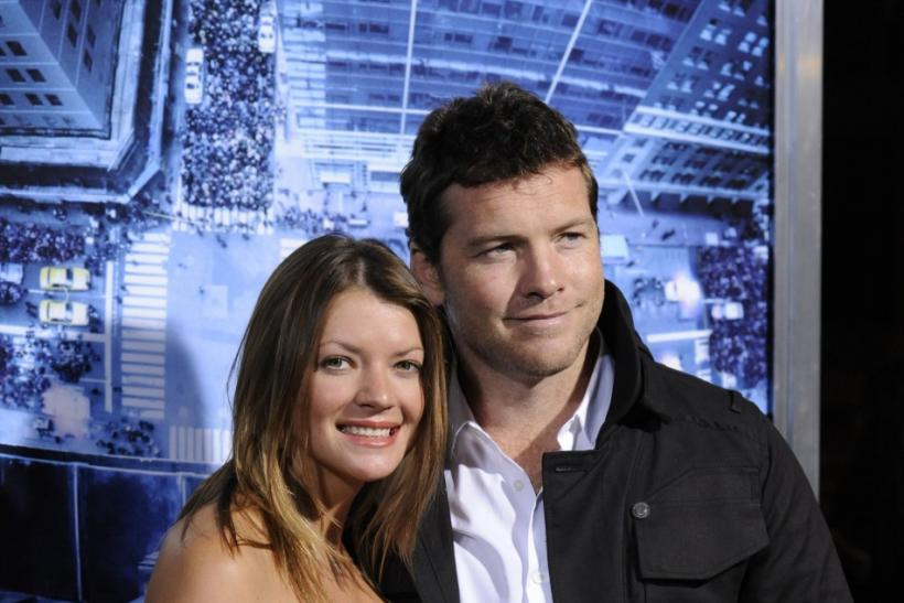 "Cast member Sam Worthington (R) and guest Crystal Humphries attend the premiere of the film ""Man on a Ledge"" in Los Angeles"