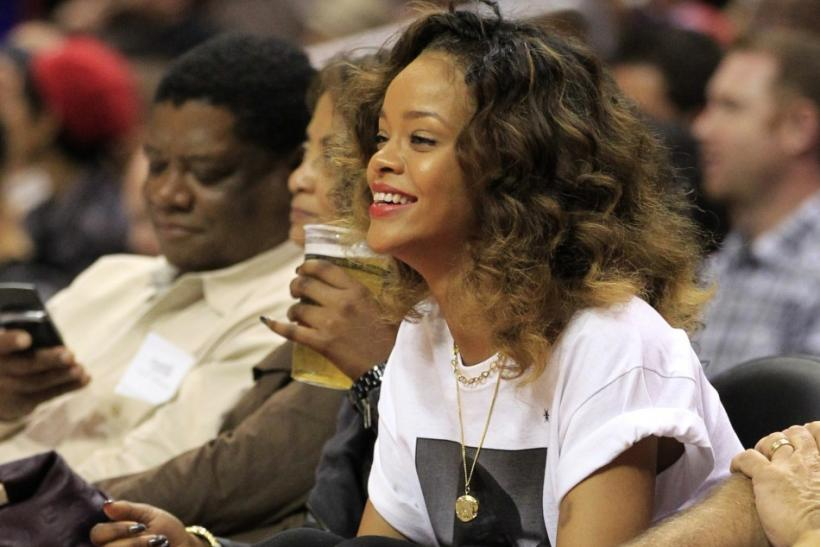 Singer Rihanna watches the Memphis Grizzlies play the Los Angeles Clippers during their NBA basketball game in Los Angeles, California