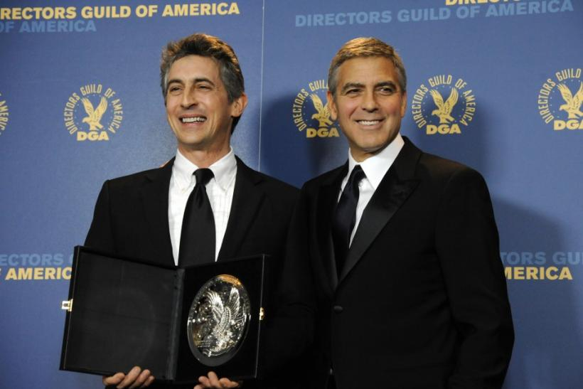 Presenter George Clooney (R) poses with Feature Film nominee Alexander Payne at the 64th annual Directors Guild of America Awards in Los Angeles