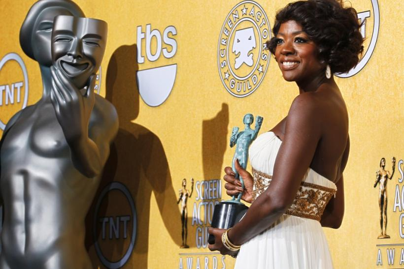 Actress Viola Davis poses with her award for outstanding performance by a female actor in a leading role at the 18th annual Screen Actors Guild Awards in Los Angeles