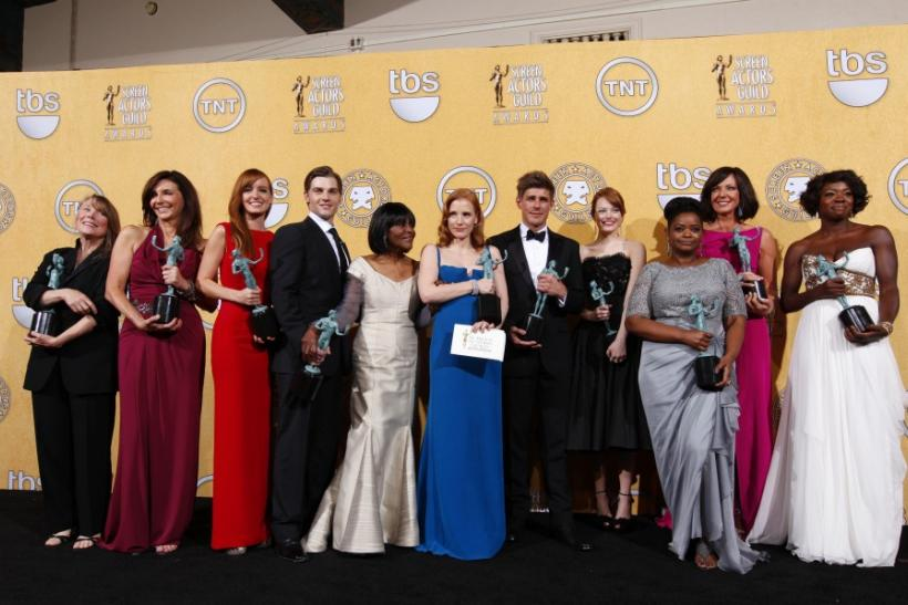 "The cast of ""The Help"" poses for photographs backstage with awards for ""outstanding performance by a cast in a motion picture"" at the 18th annual Screen Actors Guild Awards in Los Angeles"