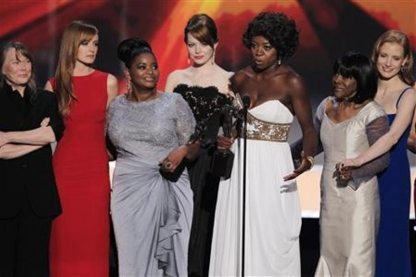 "The cast of ""The Help"" accept the award for outstanding performance by a cast in a motion picture at the 18th annual Screen Actors Guild Awards in Los Angeles, California"