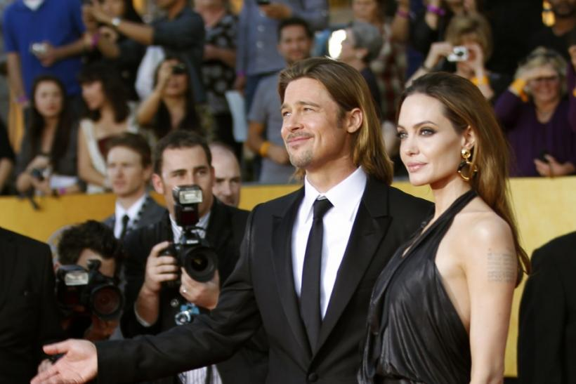 "Actor Brad Pitt from the film ""Moneyball"" and actress Angelina Jolie pose on arrival at the 18th annual Screen Actors Guild Awards in Los Angeles, California"