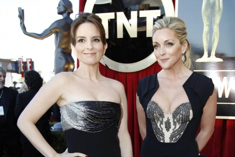 "Actresses Tina Fey (L) and Jane Krakowski, from the television series ""30 Rock,"" arrive at the 18th annual Screen Actors Guild Awards in Los Angeles, California"