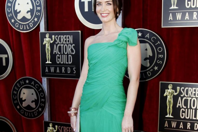 Actress Emily Blunt poses as she arrives at the 18th annual Screen Actors Guild Awards in Los Angeles, California