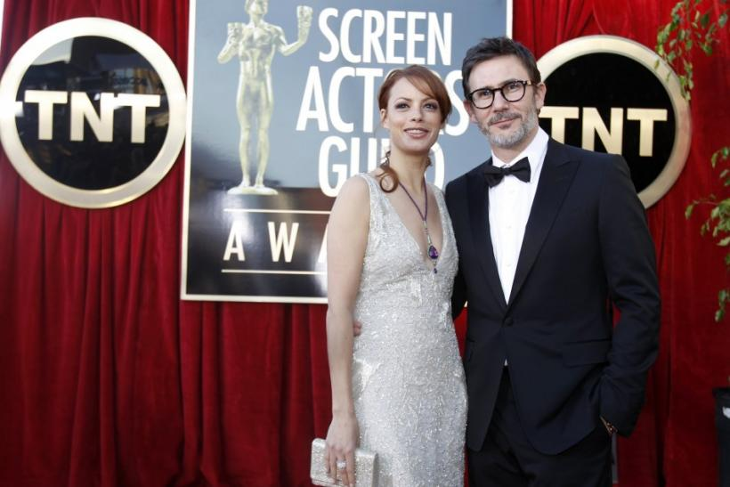 "Director Michel Hazanavicius and his wife, actress Berenice Bejo, both from the film ""The Artist,"" arrive at the 18th annual Screen Actors Guild Awards in Los Angeles, California"