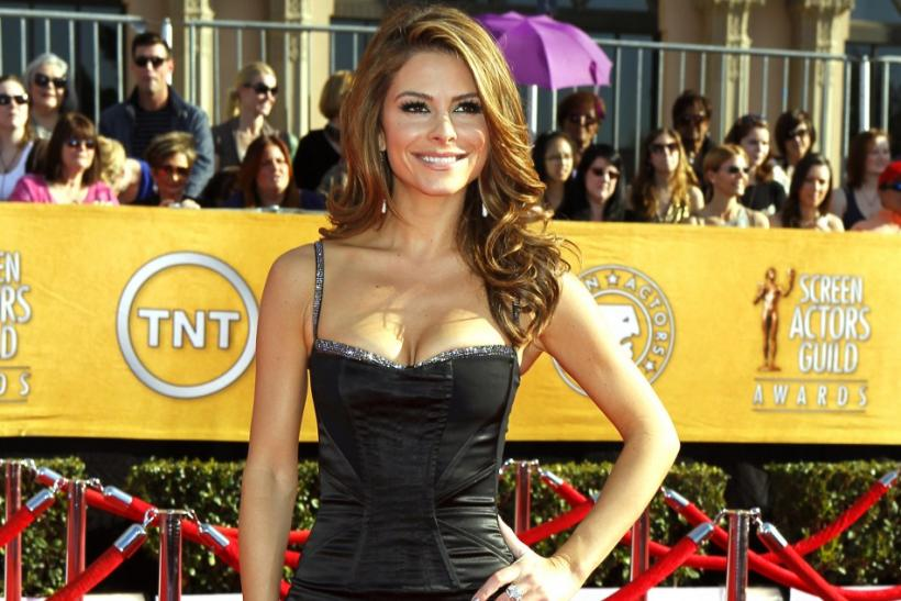 Maria Menounos poses on arrival at the 18th annual Screen Actors Guild Awards in Los Angeles, California