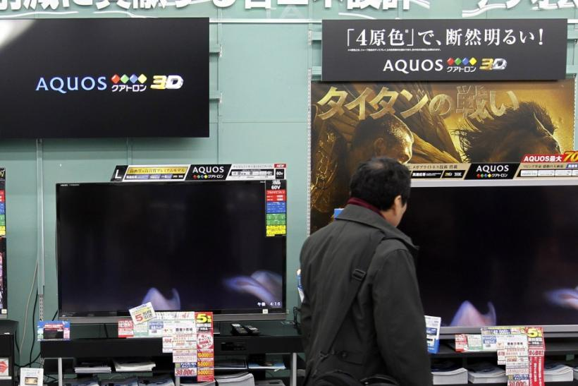A man looks around Sharp's TV sets at an electronics store in Tokyo