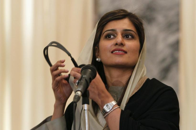 Pakistan's Foreign Minister Hina Rabbani Khar reacts after a question during a news conference in Kabul