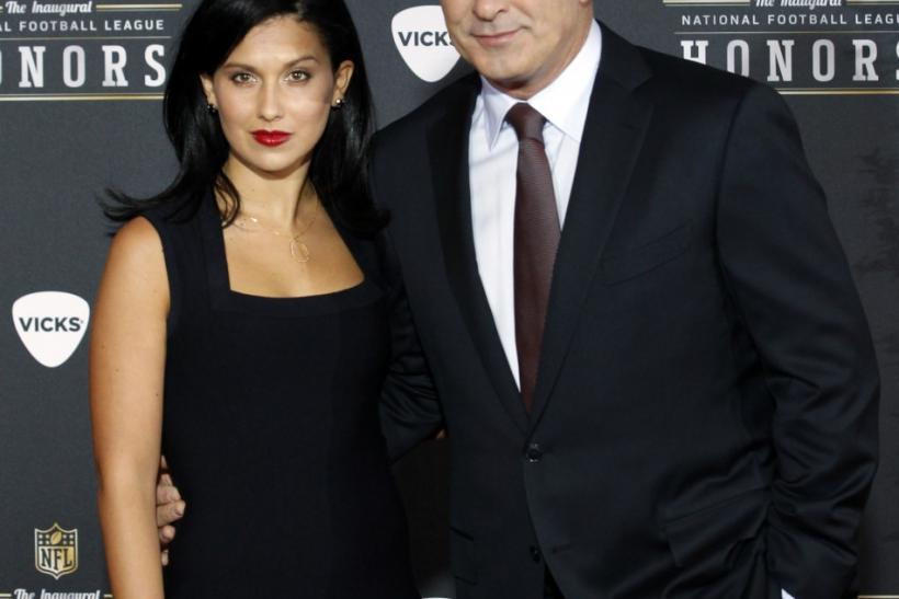 Host Alec Baldwin (R) and girlfriend Hilaria Thomas arrive for the Inaugural National Football League Honors at Super Bowl XLVI in Indianapolis, Indiana