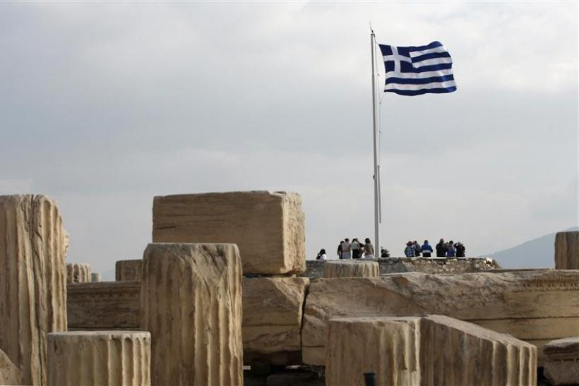 A Greek national flag flies at the archaeological site of the Acropolis Hill in Athens
